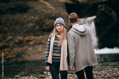 Iceland couple wearing Icelandic sweaters in beautiful nature landscape on Iceland. Woman and man model in typical Icelandic sweater. - 189456666