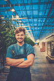 Happy man on a tomato farm - 189460489