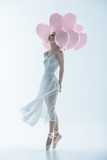 tender ballet dancer in white dress with pink balloons, isolated on white - 189461423