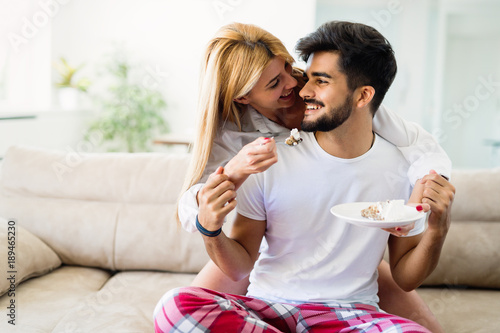 Cute young cheerful couple spending time at home