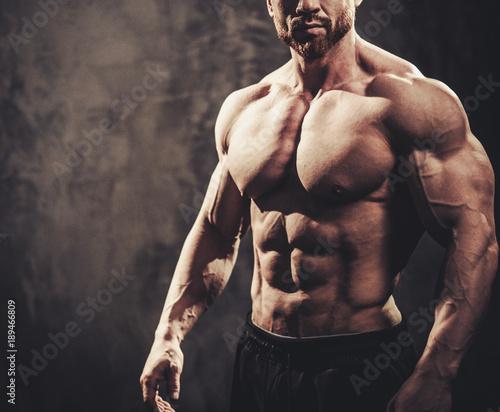 Plexiglas Fitness Man showing his muscular body