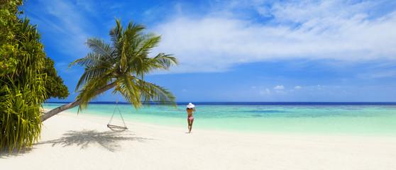 Touristen am Maledivenstrand