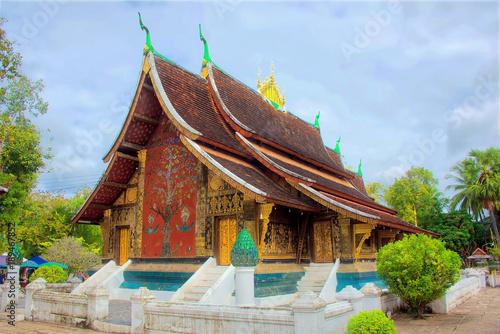 Foto Murales The temple of Wat Xieng Thong, Luang Prabang, Laos, an important religious site