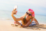 Stylish young pretty woman taking selfie on the beach - 189473270