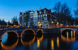 Sunset on the bridges in Canals of Amsterdam, Holland