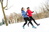 Group of friends enjoying jogging in the snow in winter - 189482456