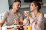 Portrait of a happy loving couple having breakfast - 189487239