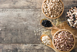 Uncooked assorted legumes in wooden bowl .Top view copy space on wooden table - 189500883