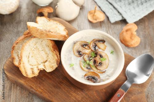 Fotobehang Kruiden 2 Bowl with mushroom soup on wooden board