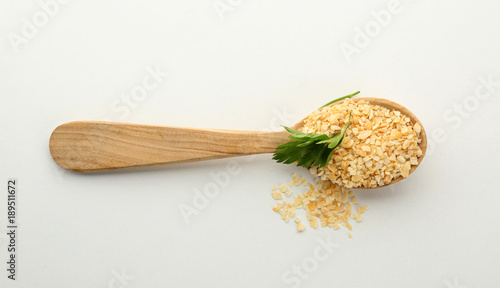 Fotobehang Kruiden 2 Spoon with granulated dried garlic on white background