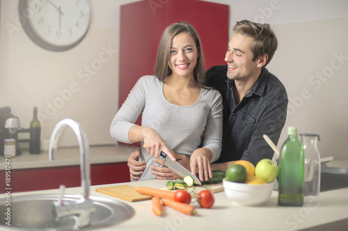 Foto Murales Sweet couple preparing the meal together