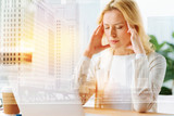Calm mind. Portrait of thoughtful office manager standing at the table with closed eyes while touching her temples with fingers - 189523671