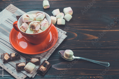 Foto op Canvas Chocolade hot chocolate with marshmallows on wooden rustic background