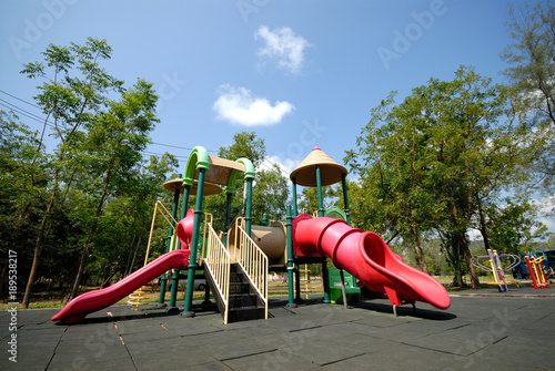 Foto Murales Colorful children playground in the park.