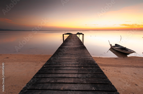 Acrylglas Pier long expose sunset photograph. contain soft focus and blur due to long expose.