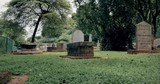 Grunge graves, ancient tombs and antique headstones of old historical cemetery - 189559045