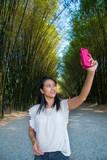 Women selfie in bamboo plant
