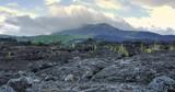 Exploring crater of Batur volcano. Black lava stones and rocks nature landscape background and scenic Bali landmark - 189563232