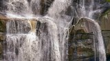 Close up view of beautiful and large waterfall falling down from big mountain cliff of rocks and stones - 189563244