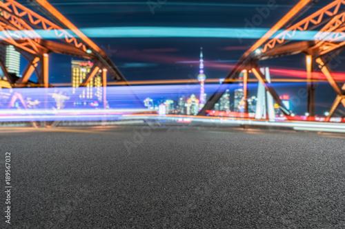 Foto op Canvas Shanghai clean road on steel bridge with car light trails in shanghai