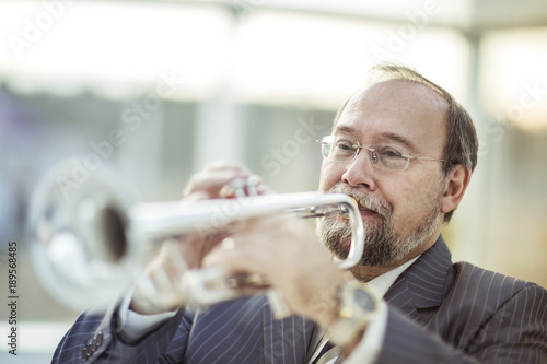 portrait of a musician with a pipe on a light background Poster
