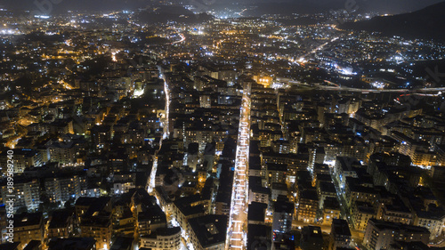 Staande foto Napels Aerial night view on the north part of the city of Naples, Italy. The streets are lit and surrounded by buildings and buildings.