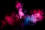 hand inside colorful smoke on black background - 189589816
