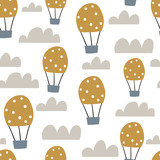 Childish seamless pattern with hot air ballon in the sky. Cute cartoon background. Perfect for fabric, textile, wrapping.Vector Illustration - 189593809