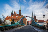 Tumski bridge and Holy Cross church in Wroclaw, Silesia, Poland