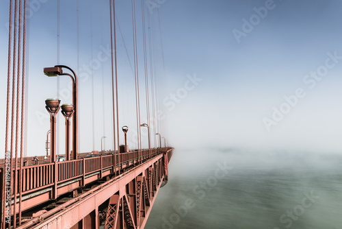 Fotobehang San Francisco Fog over San Francisco. Part of the famous Golden Gate Bridge. The ocean coast near San Francisco, California.
