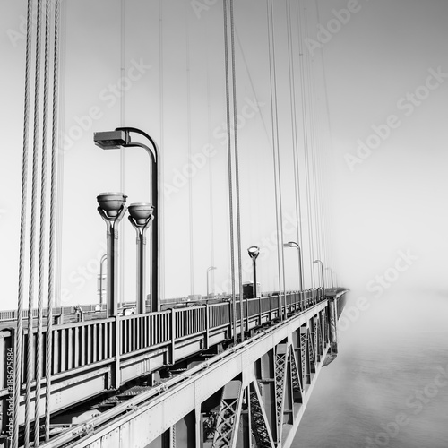 Fog over  Golden Gate Bridge. San Francisco. Part of the famous Golden Gate Bridge. The ocean coast near San Francisco, California. Black and white.