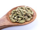 whole cardamom seeds  on wooden spoon isolated on white background - 189628658