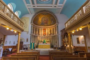 LONDON, GREAT BRITAIN - SEPTEMBER 18, 2017: The nave of church Our Lady of the Assumption with mosaic of Coronation of Virgin Mary in main apse form end of 19. cent. designed by Francis Bentley.