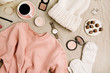 Female fashion look with stylish clothes and accessories. Lifestyle flat lay, top view composition with sweatshirt, cosmetics and coffee.