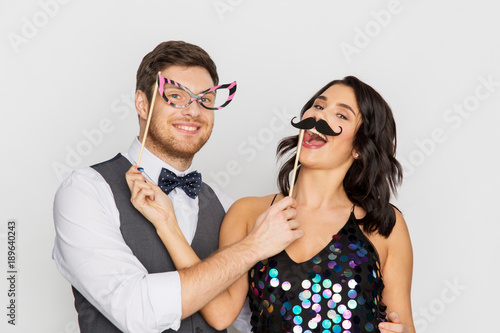 happy couple with party props having fun