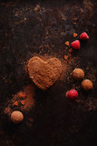 Truffles in heart shape, for valentine's day on old black metal background. - 189644440