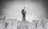 Successful confident businessman in suit. - 189647049