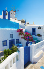 Santorini - The look to windmill and little typically white-blue chapel in Oia.