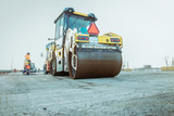 Road roller building the new asphalt road  - 189665451