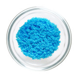 Cupric sulfate in glass bowl, isolated on white background. Bright blue copper sulfate CuSO4, also blue vitriol or bluestone. Salt, used in swimming pools, fireworks and in schools to grow crystals. - 189673881