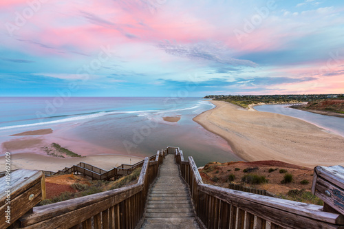 Fotobehang Lichtroze The wooden staircase leading down to the mouth of the Onkapringa river Port Noarlunga