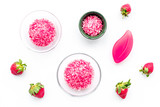 Cosmetics for skin care and relaxation. Strawberry pink spa salt on white background top view