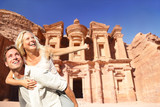 Jordan travel couple tourists happy at The Monastery, Petra's largest monument, in Jordan. - 189707496