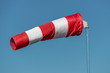 windsock in front of blue sky - 189723456