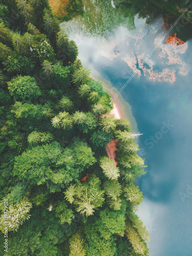 A view from above on mountain lake and forest around it