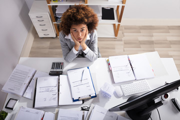 Worried Businesswoman Looking Up In Office