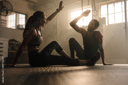 Fridge magnet Fit couple high five after workout in health club