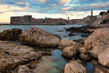 Sunrise in Dubrovnik, a landscape overlooking the old town and large stones in the foreground, Croatia - 189736632