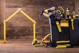 House Made Of Measuring Tape With Tools Box - 189743452