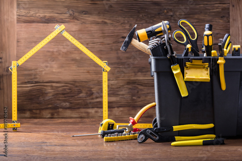 House Made Of Measuring Tape With Tools Box